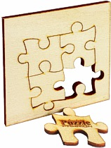 Holz in Puzzle-Form lasergeschnitten